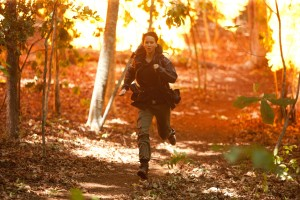 Katniss running from fireballs. From thehungergamesmovie.org, copyright Lionsgate/Murray Close
