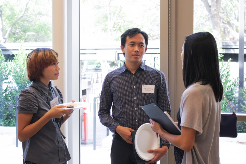 Scholarship recipient Eric Tang speaks with other attendees of the event.
