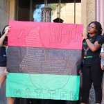Students hold Black Lives Matter poster. Photo by Karin Chan.