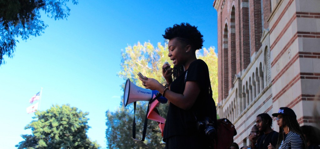 Kya Lou, ASU's Internal Public Relations Coordinator, reciting ASU's list of demands from October that was in response to the Kanye Western Party. Photo by Karin Chan.