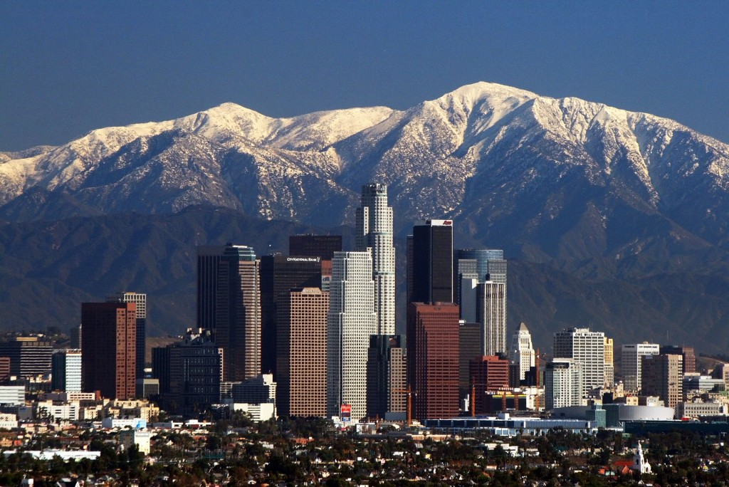 Photo of Los Angeles skyline and San Gabriel mountains via Wikimedia Commons
