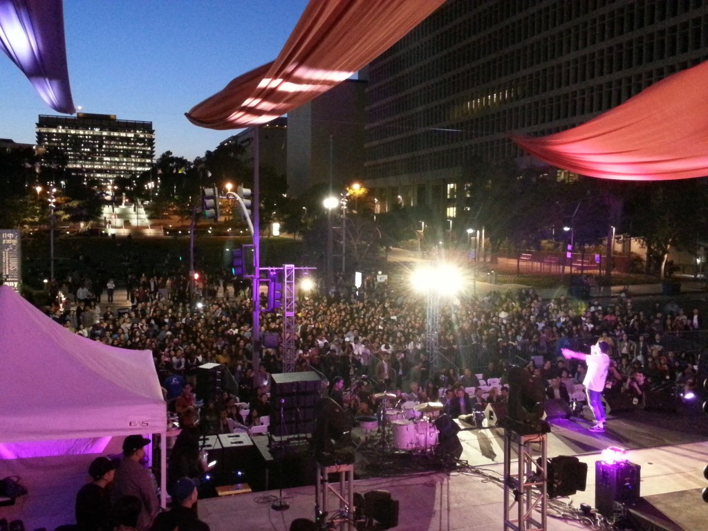 Dumbfoundead in front of a diverse crowd on Spring Street in front of City Hall. Photo by May Zeng