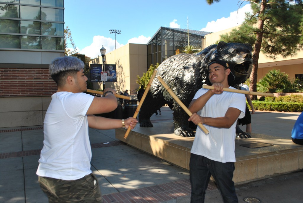 Pictured from left to right: Enrico Cortez practicing a choreographed fight scene with his partner, Michael Estabillo.